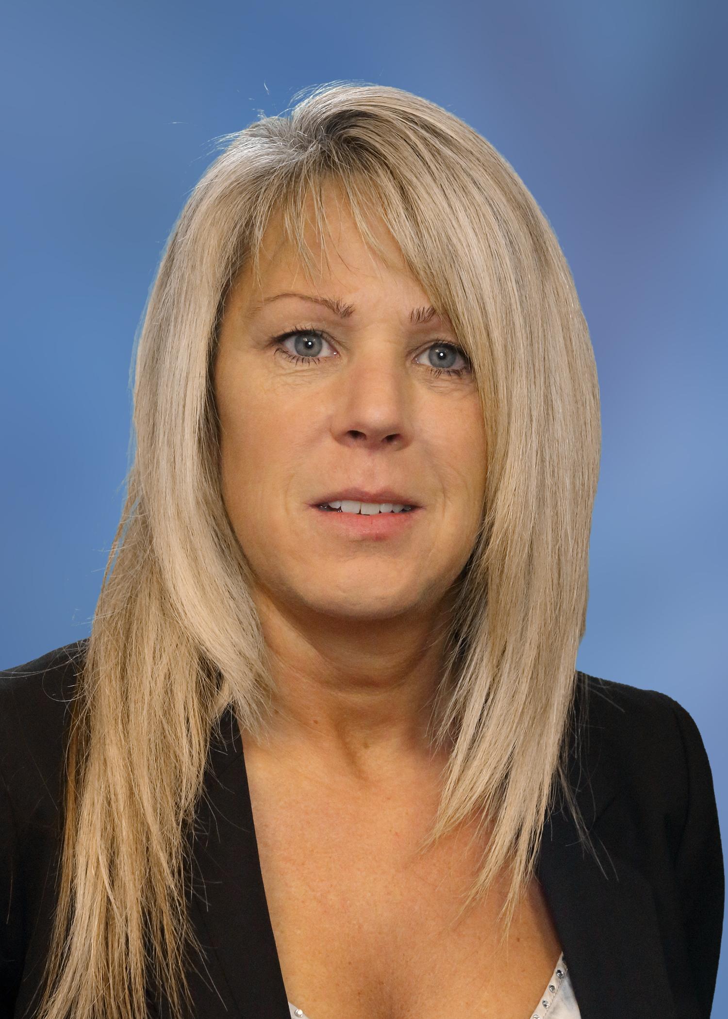 Nicolette Mason blue background